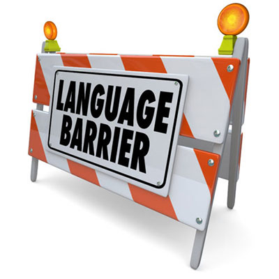 """Conceptual image of a construction barricade with a sign saying """"language barrier"""""""
