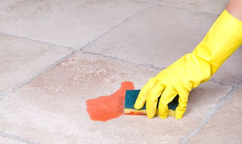 A food chemical safety image of a person cleaning a chemical spill.
