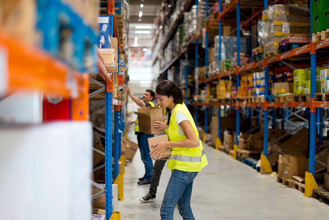 Warehouse employees handling materials